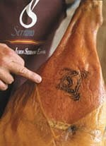 Close-up of the V-shape cut of a ham